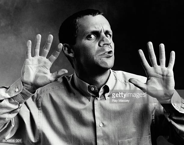 Man with face pressed up against window (B&W)