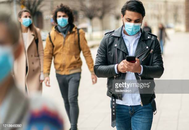 man with face protective mask - street stock pictures, royalty-free photos & images