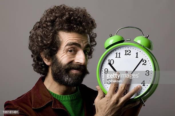 man with facial hair controling time