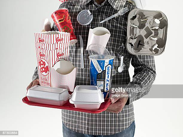 Man with fast food packaging stuck to him