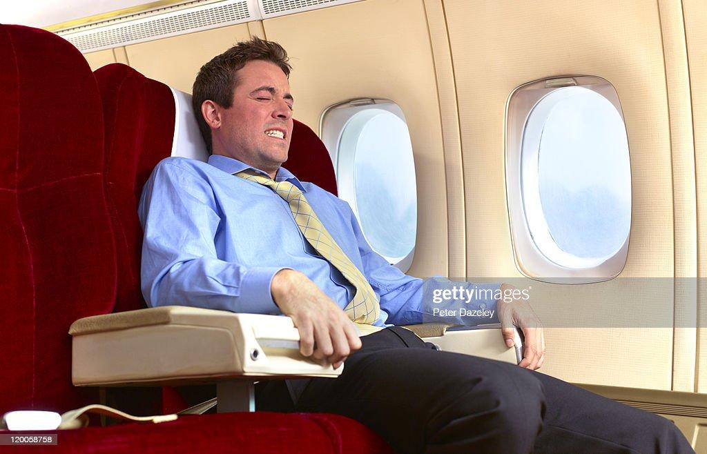 Man with fear of flying : Bildbanksbilder