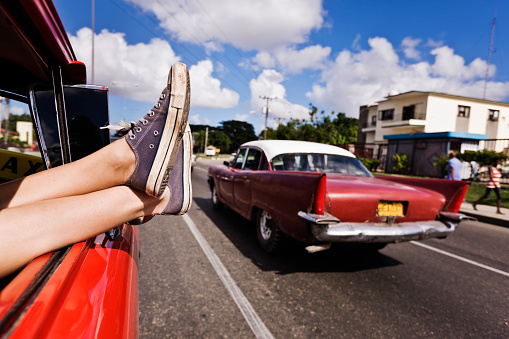 Man with feet sticking out of car window - gettyimageskorea