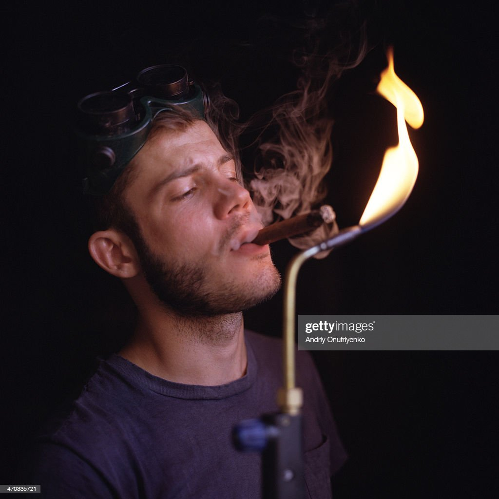 Man with fire : Stock Photo