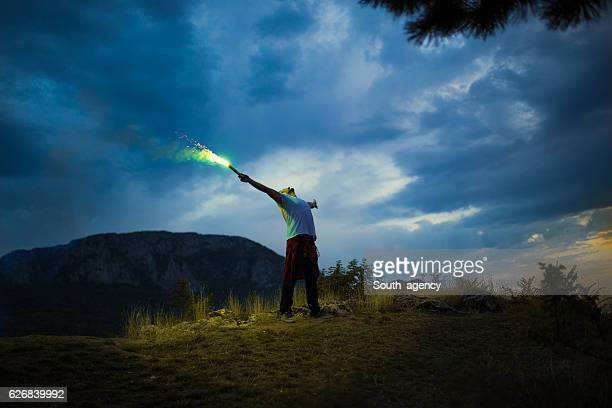 Man with flaming torch outdoors