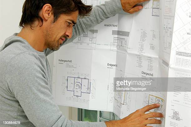Man with floor plan