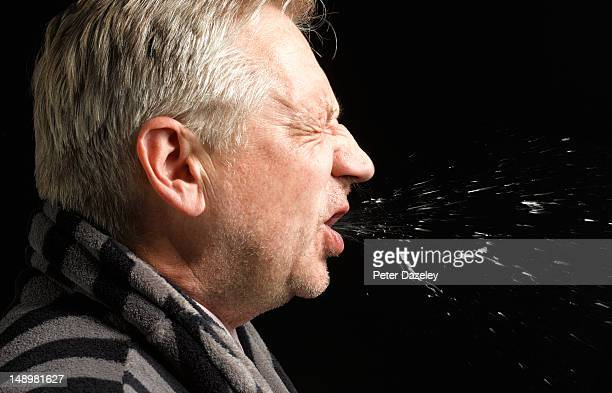 man with flu coughing and sneezing - cough stock pictures, royalty-free photos & images