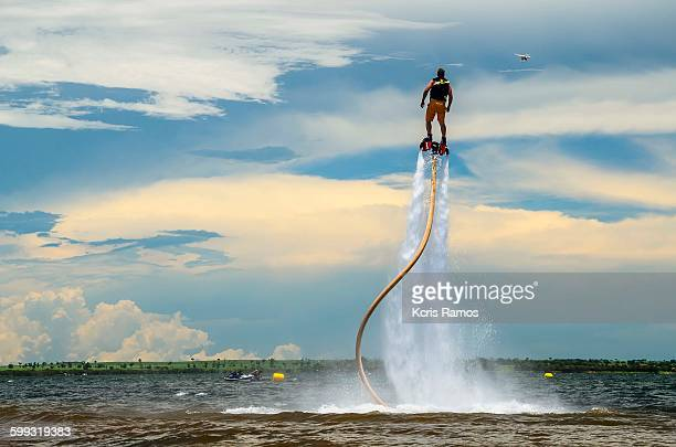 Man with flyboard boot of the sea in summer day