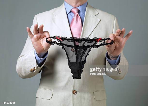 man with found underwear - knickers stock pictures, royalty-free photos & images