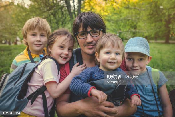 man with four children outdoors in summer - single father stock pictures, royalty-free photos & images
