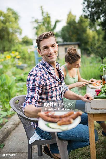 Man With Fresh Grilled Bratwurst