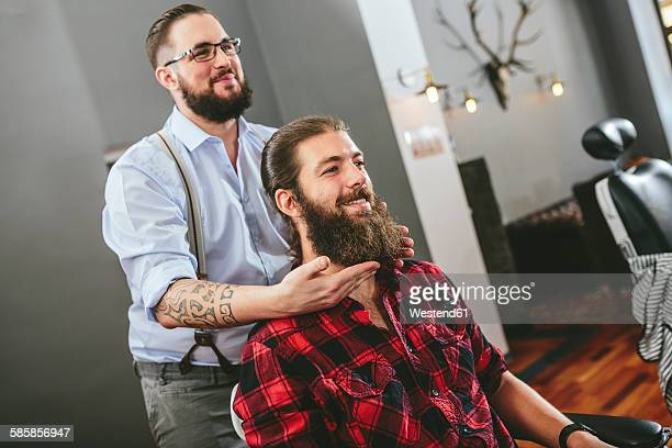Man with full beard at the barber
