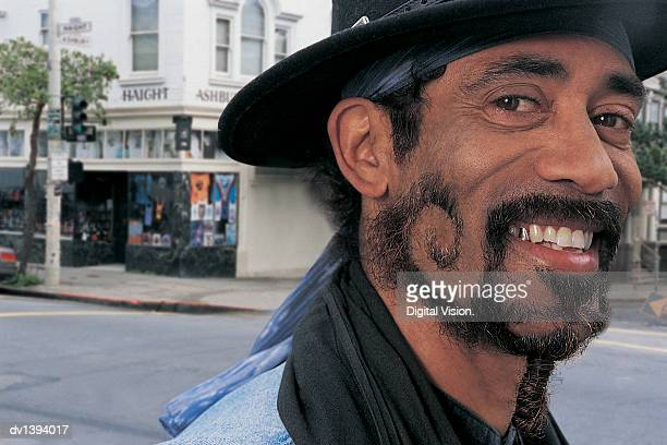 man with funky beard in haight-ashbury, san francisco - gold tooth stock photos and pictures