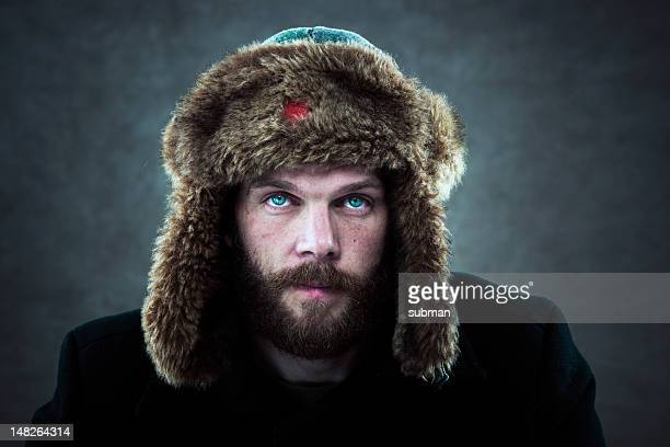 man with fur hat - fur hat stock photos and pictures