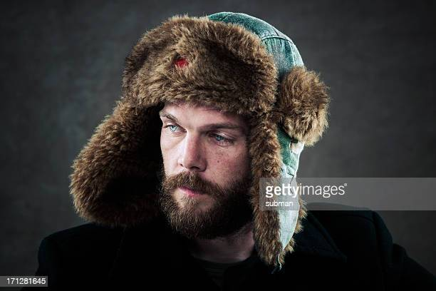 man with fur hat - fur hat stock pictures, royalty-free photos & images