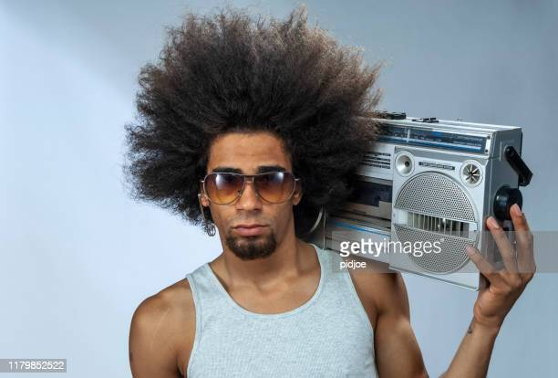 man with ghetto blaster - big hair stock pictures, royalty-free photos & images