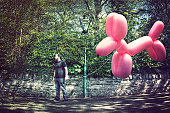 Man with giant balloon dog