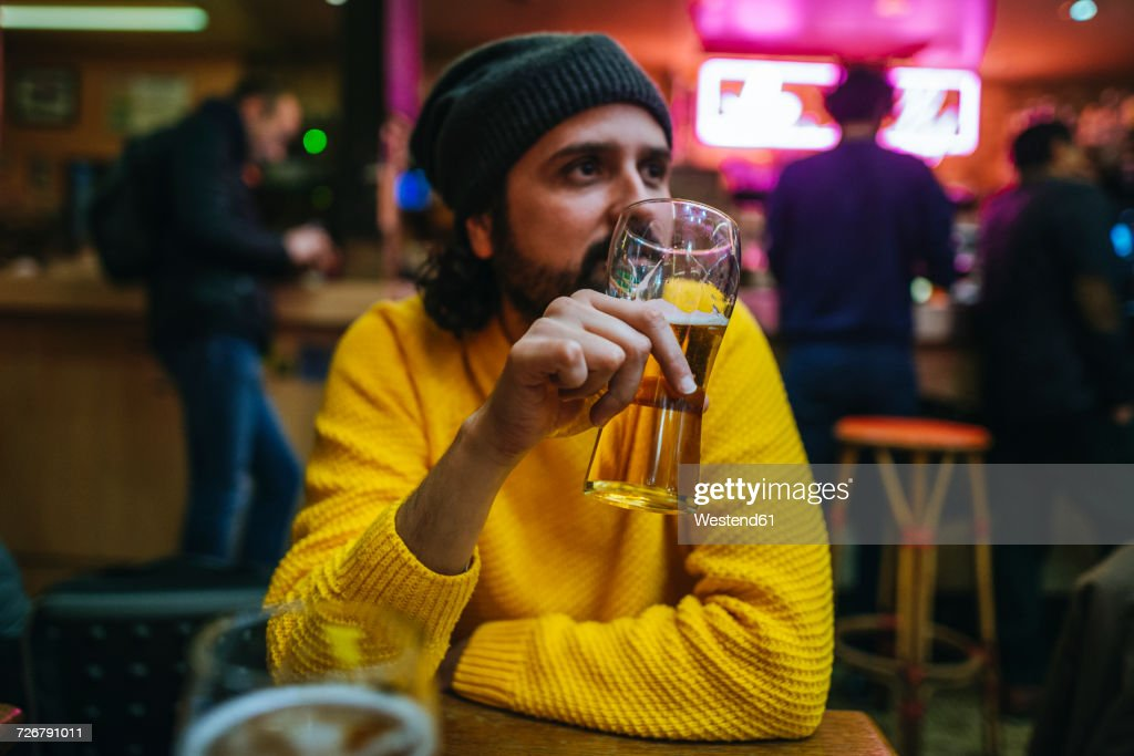Man with glass of beer in a pub : Stock Photo