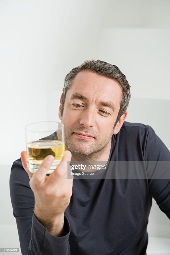 Man with glass of whisky : Stock Photo