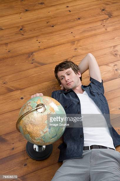 man with globe - floorboard stock photos and pictures