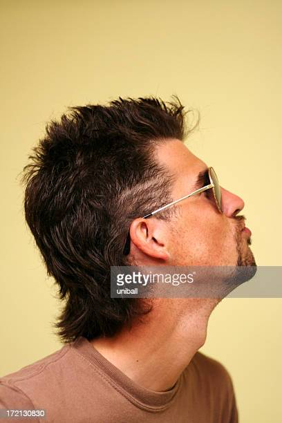 Man with goatee, mullet, and aviators
