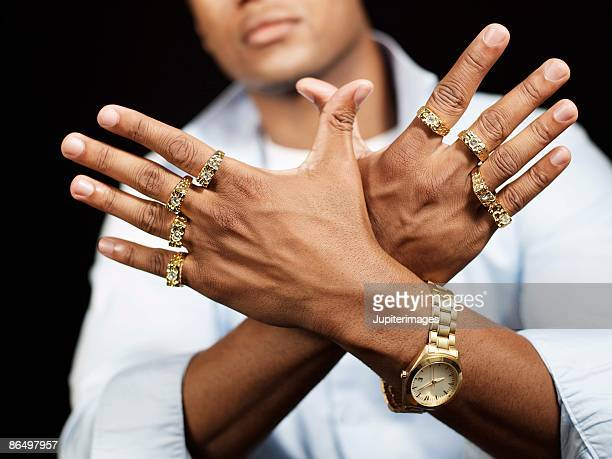 man with gold rings - bling bling stock pictures, royalty-free photos & images