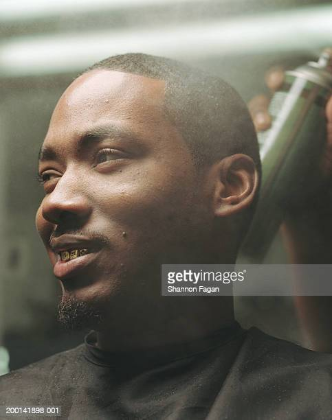 man with gold teeth in barber's chair - ゴーティー ストックフォトと画像