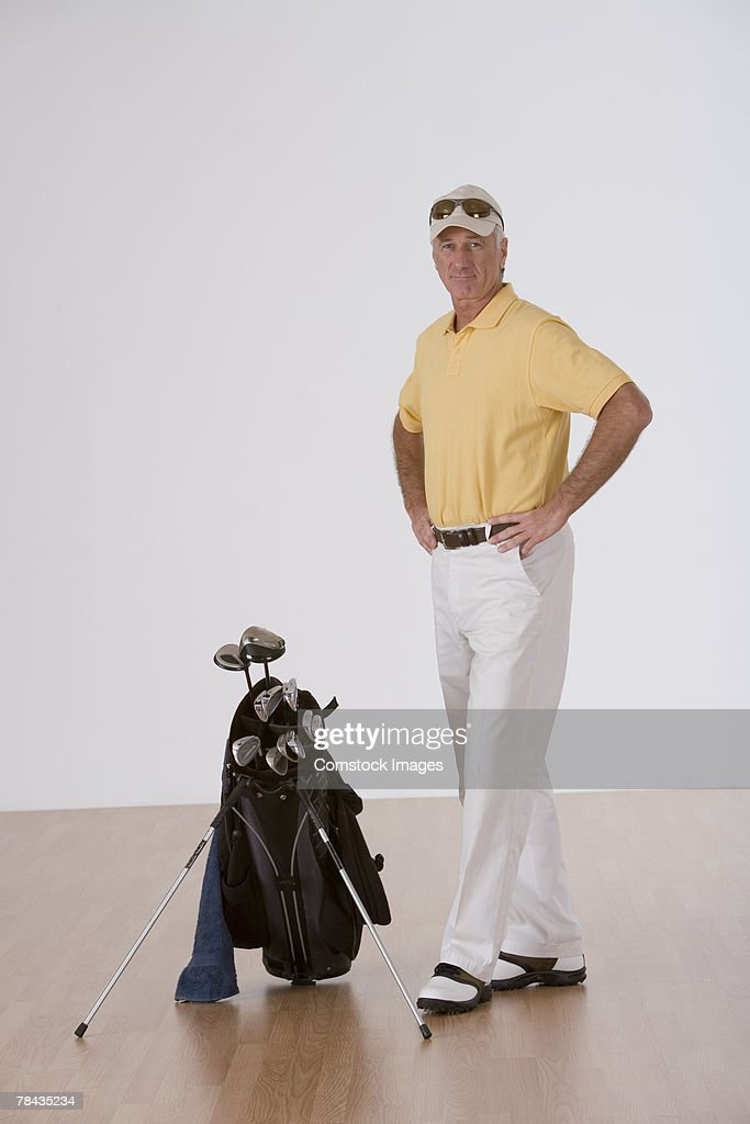 Man with golf clubs : Stockfoto