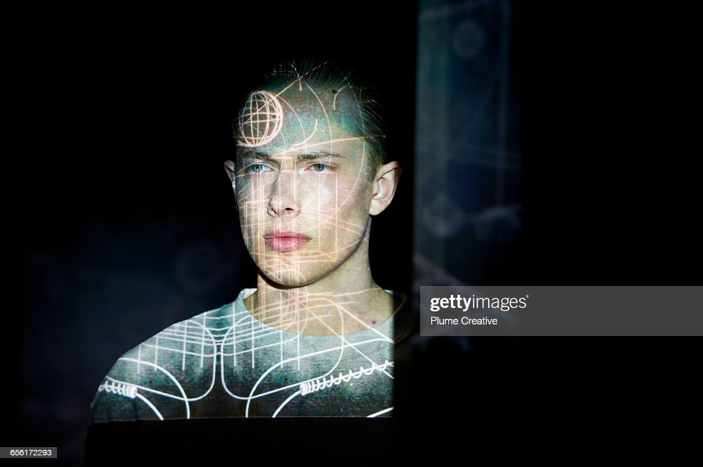 Man with graphic lines across his face : Stock Photo