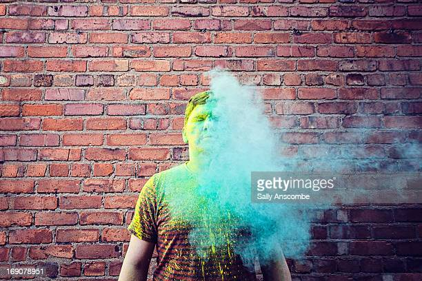 Man with green cloud covering him