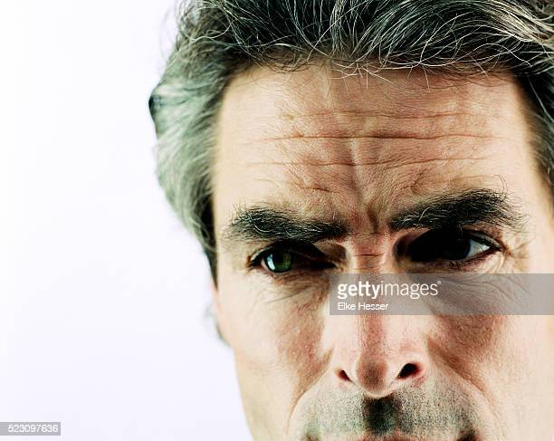 Man with Grey Hair Frowning
