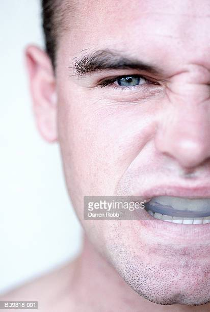 Man with gum shield in mouth, close-up