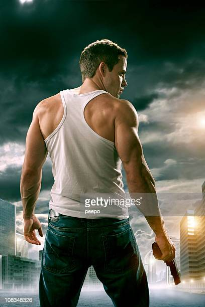 man with gun in city - guns stock photos and pictures