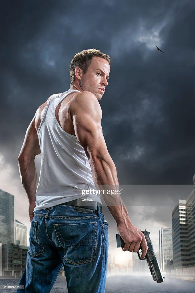 Man with Gun : Stock Photo