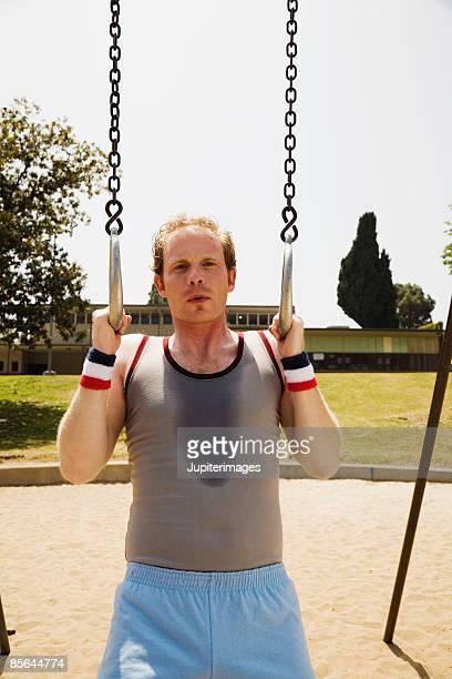 Man with gymnastics rings
