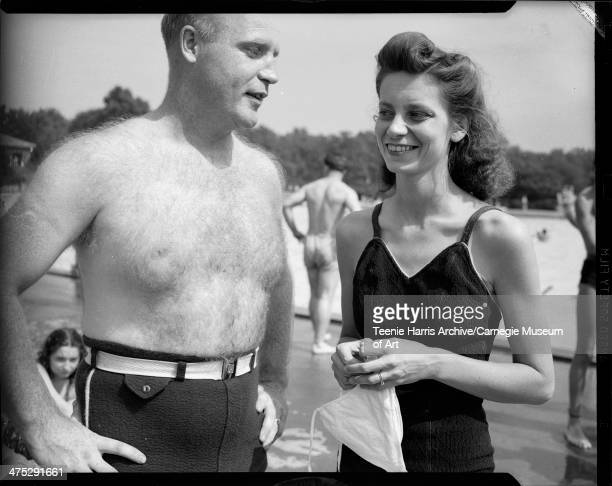 Man with hairy chest and woman wearing bathing suits at North Park pool for interracial picnic sponsored by the University of Pittsburgh Physical...