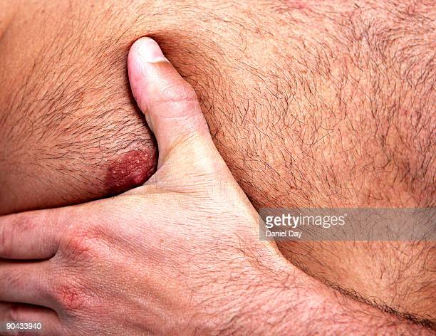 man with hand on chest - brustwarze stock-fotos und bilder