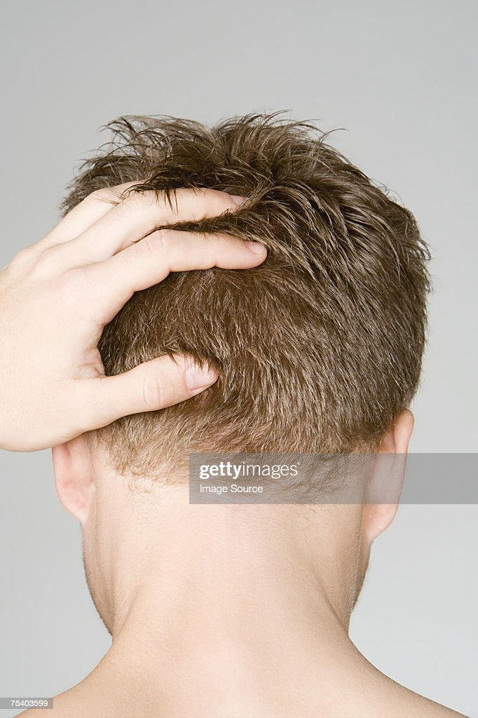 Man with hand on head : Stock Photo