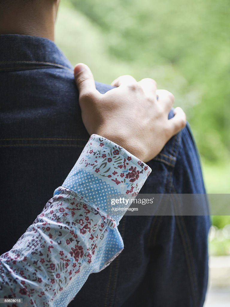 Man with hand on man's shoulder : Stock Photo