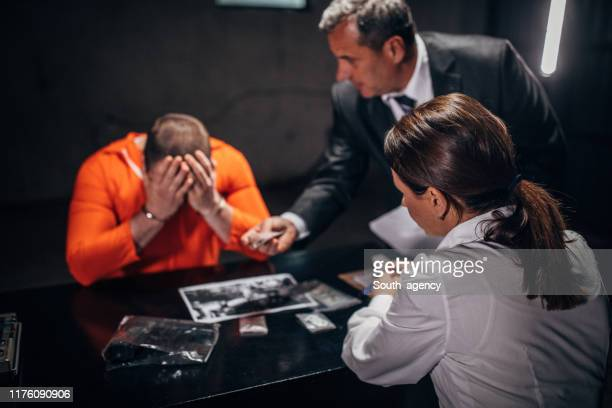 man with handcuffs and  detectives - prosecutor stock pictures, royalty-free photos & images