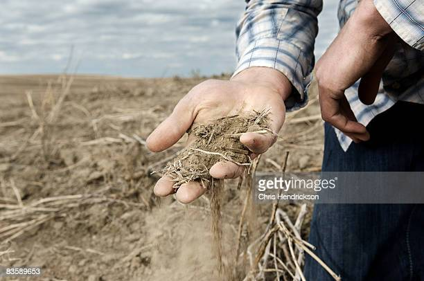Man With Handful of Dry Soil.