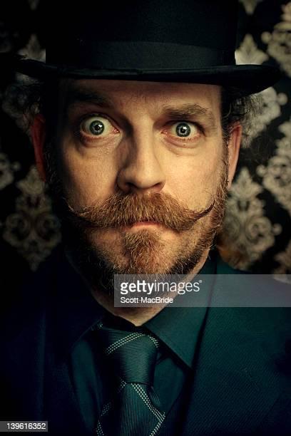 Man with handlebar moustache