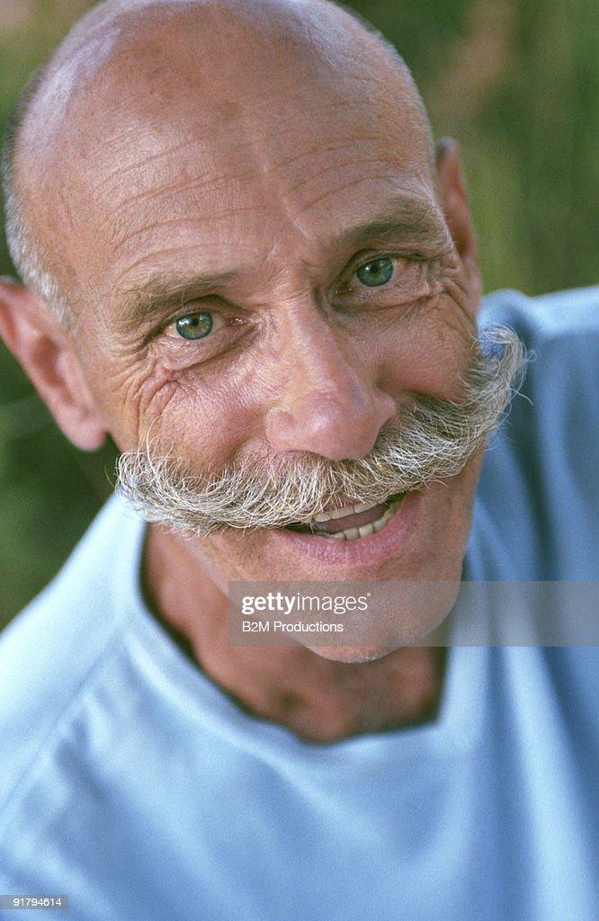 Man with handlebar mustache : Stock Photo