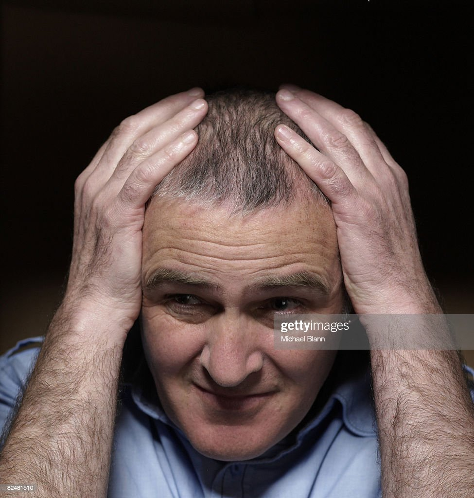 Man with hands atop head : Stock Photo