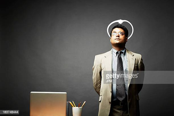 man with hands behind back looking angelic - angel halo stock pictures, royalty-free photos & images