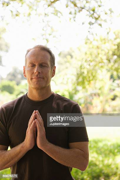Man with hands in anjali mudra