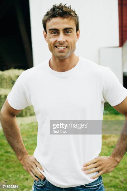 Man with hands on hips on farm