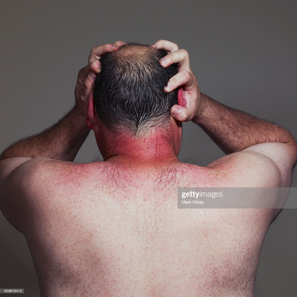 Man with hands on his head : Stock Photo