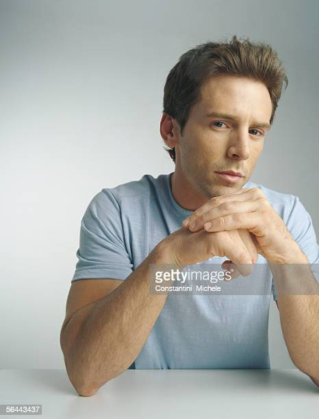 Man with hands together, portrait
