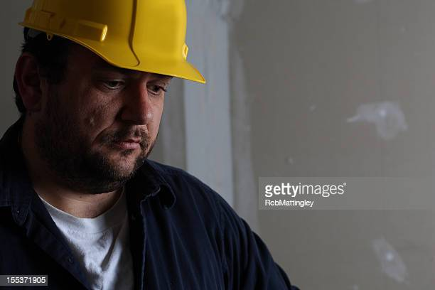 Man with hard hat doing construction