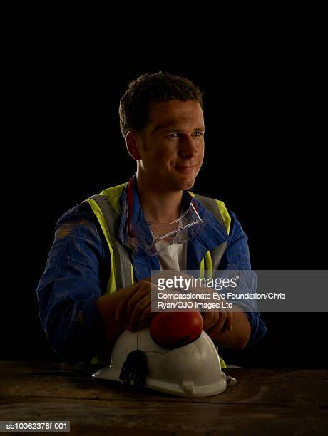 man with hardhat sitting at desk, smiling - cef stock pictures, royalty-free photos & images
